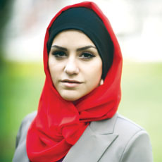 A provider refused to let a Muslim woman wear a hijab, the government charges.