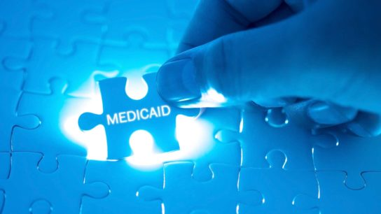 hand placing Medicaid puzzle piece
