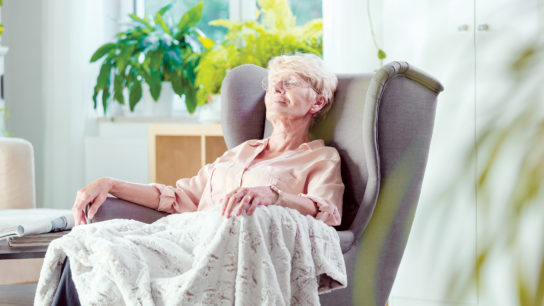 Senior relaxing in comfy chair