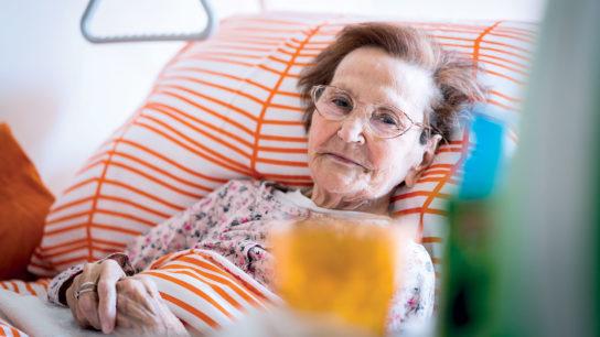 Senior in hospital bed