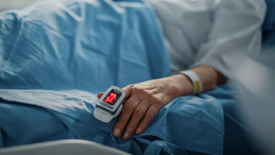 Hand-pulseOximeter-covid-19-bed-ill-illness-sick-infection-infected-resident-nursingHome-GettyImages-1321691734.jpg